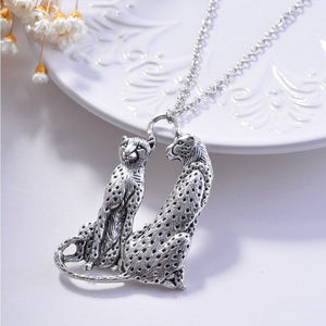 Silver tone sweater necklace with cheetahs pendant